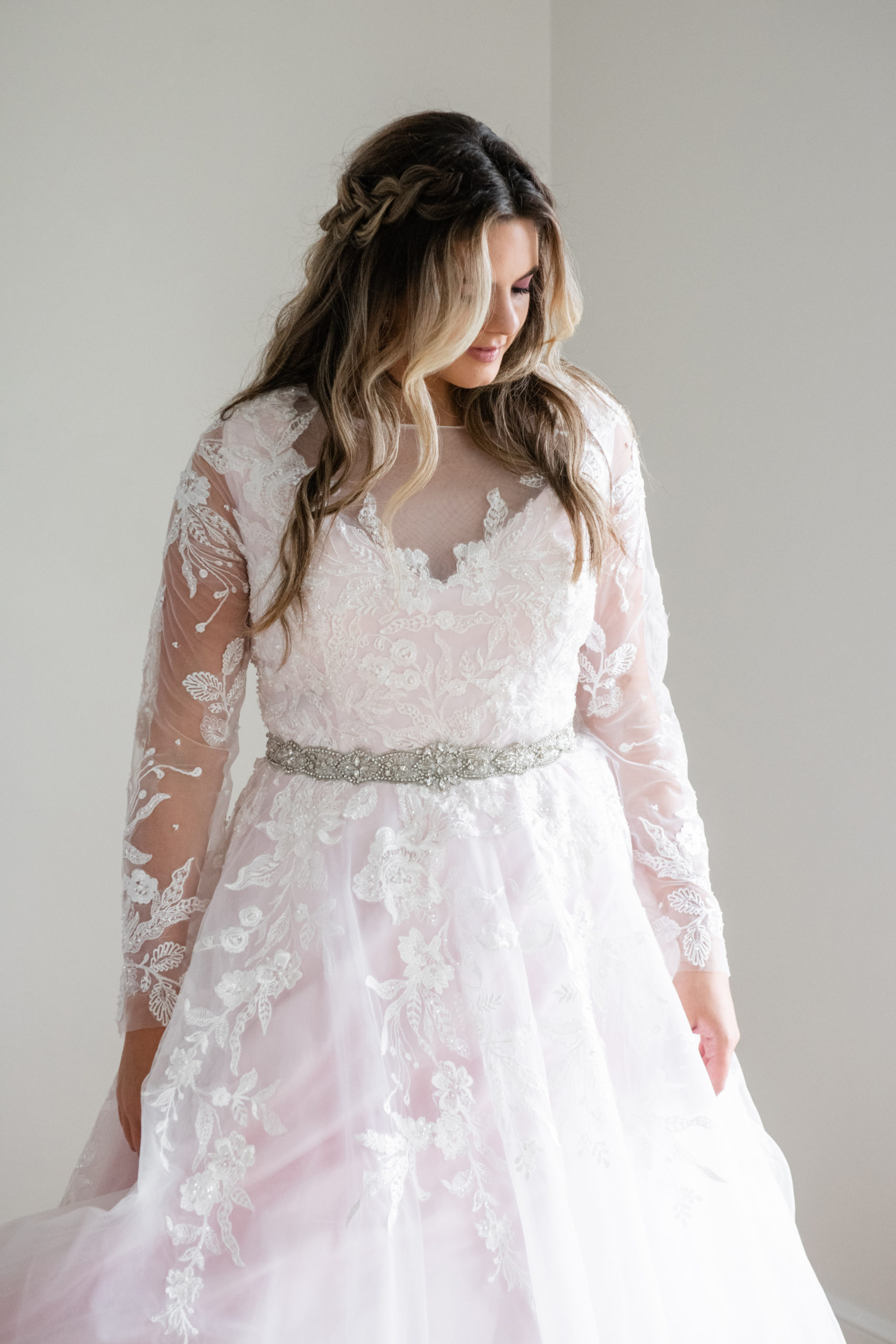try your plus size wedding gown on | andi b bridal