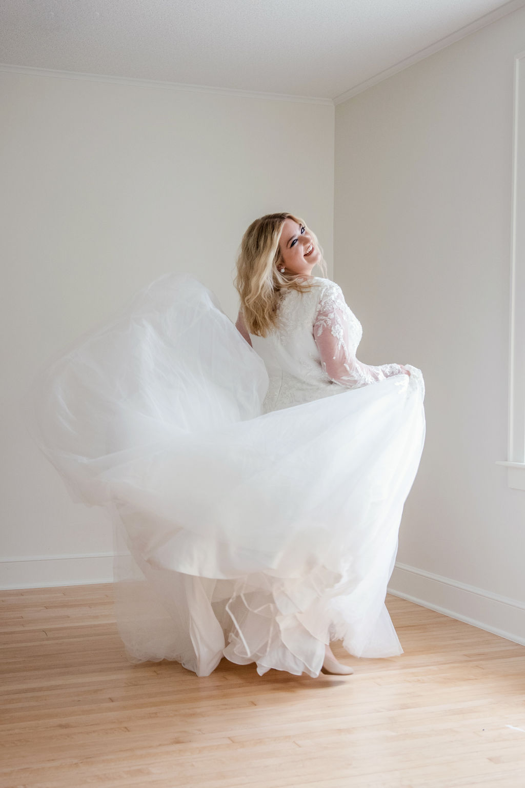 try your plus size wedding gown on at your boutique appointment